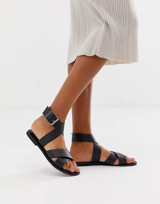 Flossy Asos Design ASOS DESIGN leather cross strap flat sandals