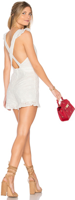 J.O.A. Ruffle Shoulder Eyelet Romper $90 thestylecure.com