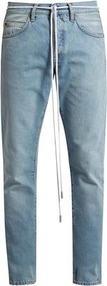 OFF-WHITE Spray-print slim-leg jeans $335 thestylecure.com