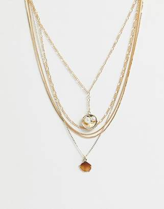 Asos Design DESIGN multirow necklace with sea shell pendants and mixed chains in gold