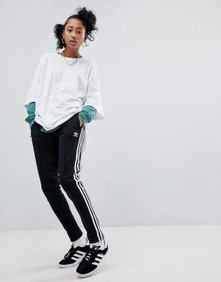 sneakers for cheap 92c3c 63e1c adidas adicolor three stripe track pants in black