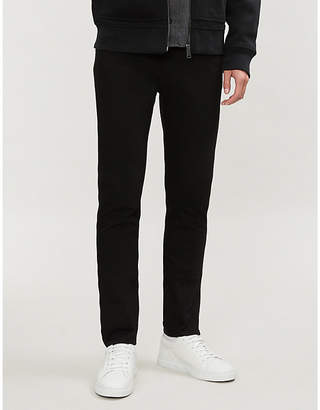 Burberry Slim-fit tapered stretch-denim jeans