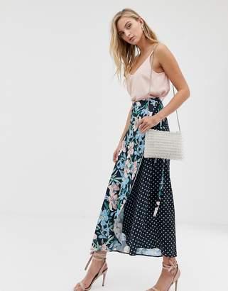 Liquorish mix and match floral and polka print wrap skirt