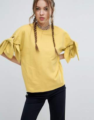 ASOS Sweatshirt With Knot Sleeve Detail $38 thestylecure.com
