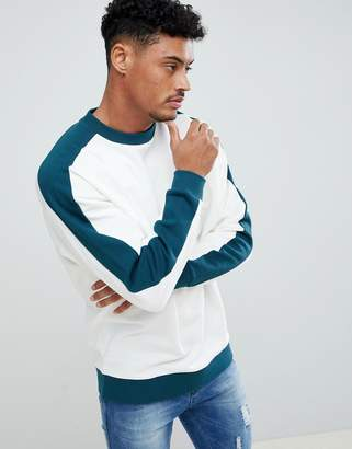Asos DESIGN Oversized Sweatshirt In White With Contrast Sleeve Panel And Ribs