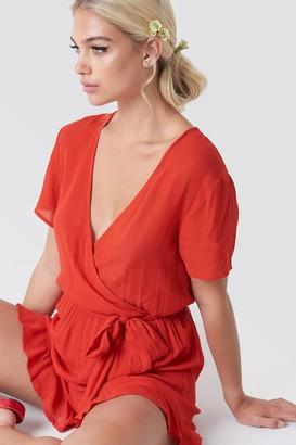 NA-KD Linn Ahlborg X Short Sleeve Wrap Playsuit