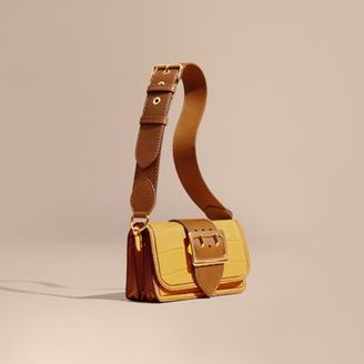 Burberry The Small Buckle Bag in Alligator and Leather $8,250 thestylecure.com