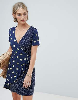 Warehouse wrap dress with ruffle detail in mixed floral and polka print