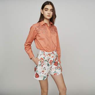 Maje Floral-print denim shorts