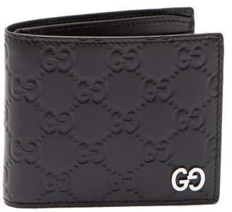 Gucci Gg Debossed Bi Fold Leather Wallet - Mens - Black