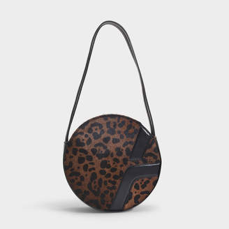 Most Wanted Design by Carlos Souza Manu Atelier Lou Round Box Bag In Black And Leopard Printed Calf Hair And Vegetable Tanned Calf Leather