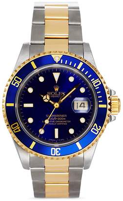 Pre-Owned Rolex Stainless Steel and 18K Yellow Gold Two Tone Submariner Watch with Blue Dial, 40mm $11,650 thestylecure.com