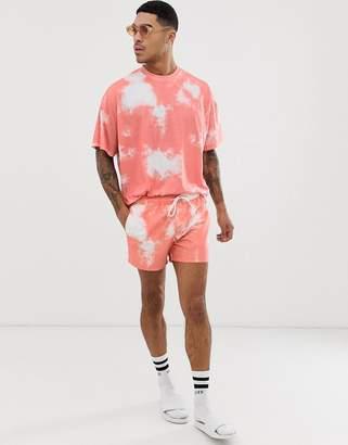 ed759ed5319d6 Asos Design DESIGN two-piece swim shorts in light pink tie dye in short  length