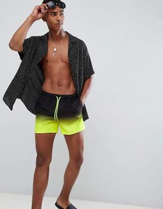 d01912bd63 Asos Design DESIGN swim shorts in black & neon yellow ombre short length