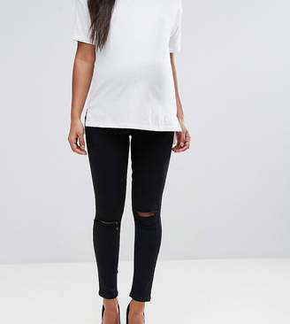 Asos DESIGN Maternity Ridley skinny jeans in clean black with ripped knees with over the bump waistband