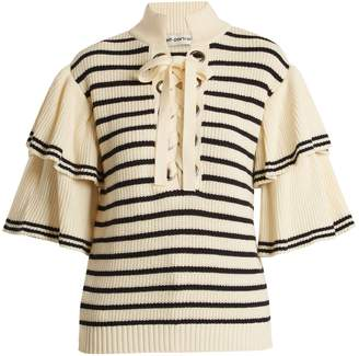 Flared-sleeve striped cotton-blend sweater