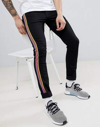 Asos DESIGN super skinny jeans in black with multicoloured side stripe