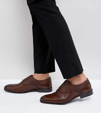 Asos DESIGN Wide Fit Oxford Shoes In Brown Leather With Emboss Panel
