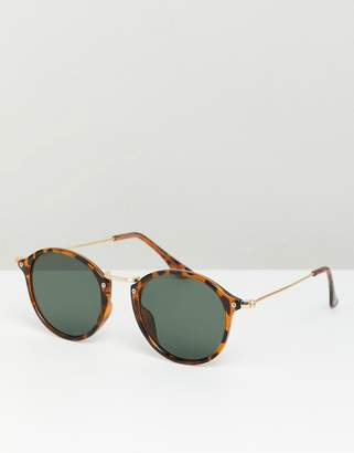 Asos DESIGN round sunglasses in tort with metal details and green lens