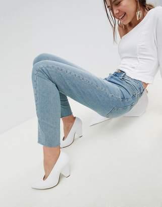 Asos DESIGN Farleigh high waist straight leg jeans in dusty mid wash with raw hem