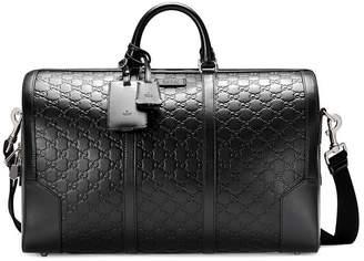 Gucci Signature leather duffle bag