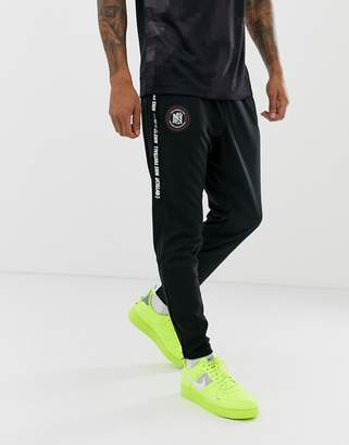 Nike FC Logo Joggers In Black