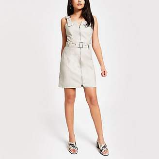 River Island Cream faux leather belted pinafore dress