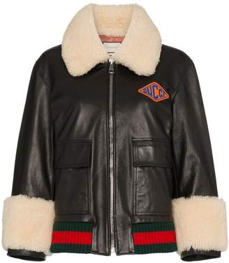 Gucci logo patch shearling trim leather bomber jacket