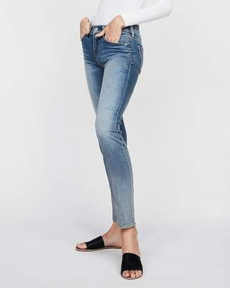 Express Mid Rise Light Wash Stretch Skinny Jeans