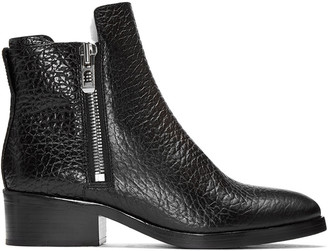 3.1 Phillip Lim Black Croc-Embossed Shearling Alexa Boots $695 thestylecure.com