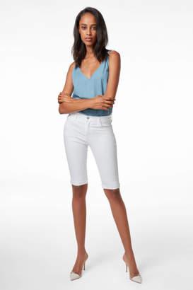 J Brand 811 Mid-Rise Skinny Bermuda Short in Blanc