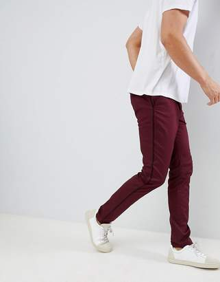 Asos Design DESIGN skinny pants in burgundy with black side piping