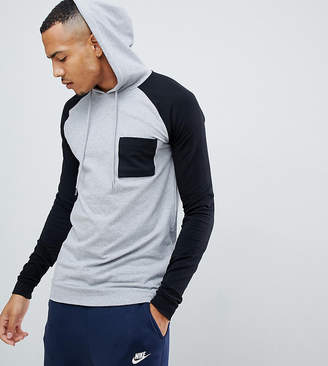 Asos DESIGN tall muscle longline hoodie with contrast raglan sleeves and chest pocket