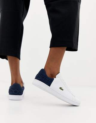 Lacoste Carnaby Evo white sneakers with navy panel