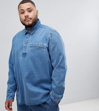 Asos DESIGN Plus oversized denim overhead shirt in mid wash