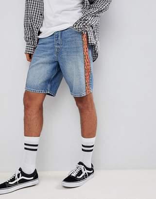 Asos DESIGN denim shorts In skater fit with geo-tribal side stripe