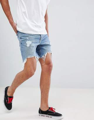 Bershka Slim Fit Denim Shorts In Mid Blue With Rips