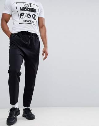Asos Design DESIGN drop crotch pants in black with metal details