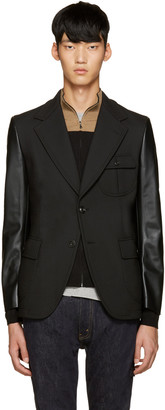 Junya Watanabe Black Faux Leather Sleeve Blazer $1,215 thestylecure.com