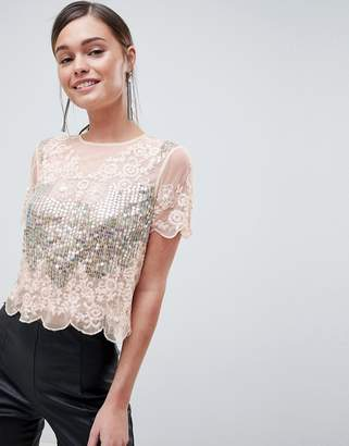 Asos DESIGN t-shirt with all over sequins & pretty lace detail in pink
