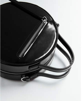 Express circle patent crossbody bag