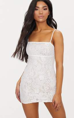 853505de1f at PrettyLittleThing · PrettyLittleThing White Lace Bodycon Dress With Nude  Lining