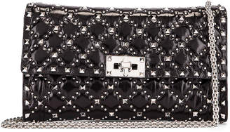 Valentino Spike Crossbody Bag in Black | FWRD