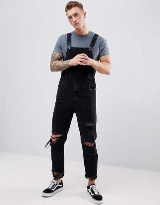 Asos DESIGN Skinny Denim Overalls In Black With Heavy Rips