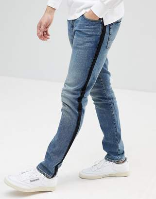 Asos DESIGN Skinny Jeans In Dark Wash Blue With Side Stripe