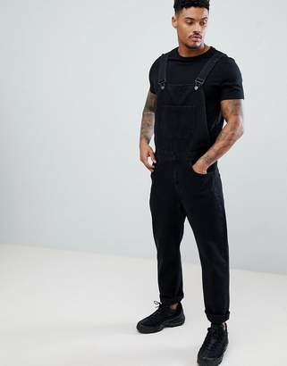 Asos DESIGN skinny denim overalls in black