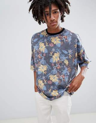 Asos DESIGN oversized longline t-shirt with all over floral print in textured fabric