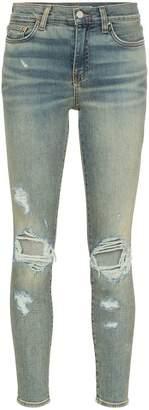 Amiri ripped knee skinny jeans