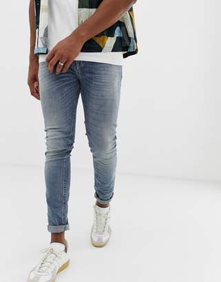 Benetton mid wash skinny jeans in rip and repair