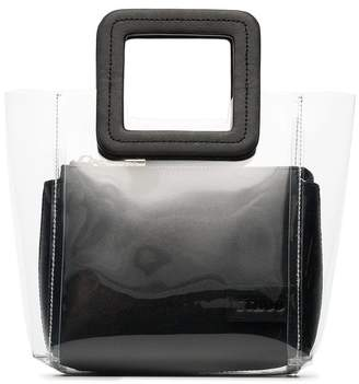 clear Staud and black shirley mini PVC and leather tote